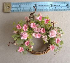 This is a beautiful dollhouse wreath to hang on your dollhouse door or wall. Blooming full pink roses, delicate pink petunias and pink