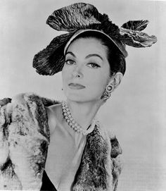 Carmen Dell'Orefice in a hat by Mr John
