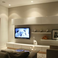 IKEA - BESTA units. Make your own TV feature walls. Great in rooms with no architectural features.