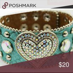 NEW LEATHER HEART RHINESTONE SNAP BRACELET A NEW turquoise color leather rhinestone heart bracelet with snap closure. Jewelry Bracelets