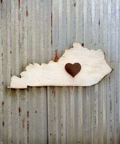 Add instant hometown-inspired flair to an indoor or outdoor wall with this playfully oversized piece. Made from southern pine plywood, it's guaranteed to lend plenty of warm, rustic charm to any living space. Plus, the heart accent is made with 100-year-old reclaimed wood for an unmistakably vintage vibe.