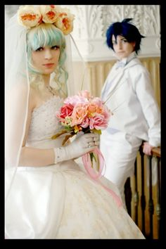 Now THAT's A Cosplay wedding. Love the groom's anime type hair!