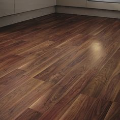 The elegant wood tones of this two strip Professional Walnut laminate flooring can be used to create a modern or classic look in a variety of settings. Walnut Laminate Flooring, Walnut Floors, Hardwood Floors, Hall Flooring, Kitchen Flooring, Flooring Options, Real Wood, New Homes, Joinery