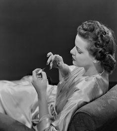 Woman applying nail varnish - National Media Museum