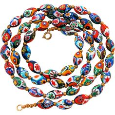 Millefiori Murano Bead Necklace - 50 Venetian Glass Oval Beads 31 Inches from Antik Avenue on Ruby Lane #muranobeadnecklace #venetianbeadnecklace