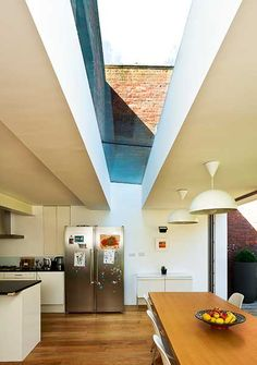 glazed link roof between old and new sections of a home