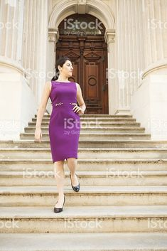 Woman Walks Down Steps of Majestic Building royalty-free stock photo