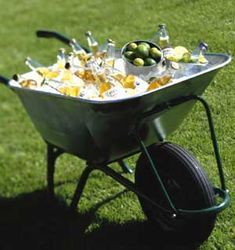 What a creative use of a wheelbarrow to serve drinks at a party