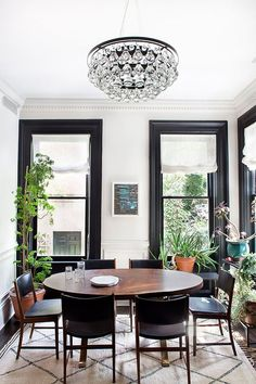Black and white dining room with moroccan rug, leather chairs, and indoor plants via @thouswellblog: