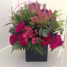 Textured grouped arrangement with exotic flowers