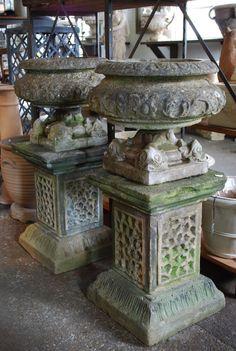 Antique English limestone urns with pedestals...