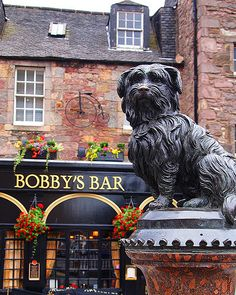 Greyfriars Bobby's Bar occupies the ground floor of a row of Georgian houses adjoining the historic Candlemakers' Hall, built in 1722.  The name of the bar is inspired by an Edinburgh legend of a scruffy Skye terrier called Bobby.  When his owner died in 1858, Bobby faithfully watched over his grave and was buried alongside his master in the Greyfriars Kiryard in 1872.  Photo: flickr.com/photos/amyallenmacleod