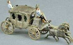 SILVER DRESDEN HORSE DRAWN COACH.