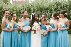 bridesmaids holding fans