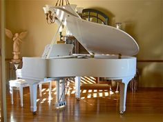 this is my baby grand, we put it in the sun room so th natural light would shine through....the accustics are beautiful....