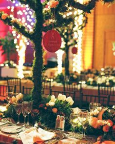 Table-number cards were hung from branches over each banquet table, and featured images of skis for this wedding in Whistler..