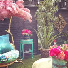 """""""I aimed to create a magical oasis for guests to escape the hustle and bustle of London. I've used my Osbourne & Little fabrics from the Samana collection, which work so well in the space. I've also collaborated with Rockett St George. They helped to source some amazing vintage garden furniture for the space so it has a really unique feel."""" Matthew Williamson. Pictured: bouquets by Rowan Blossom, Feather Lamp by A Modern Grand Tour and upholstery fabrics by Osborne & Little. Click to read…"""