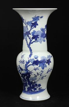 """Blue and white Gu vase, China, 17th century, open rim, decorated with flowers, bamboos, birds on rocks on the body, double ring mark on base, 18 1/4"""" h."""