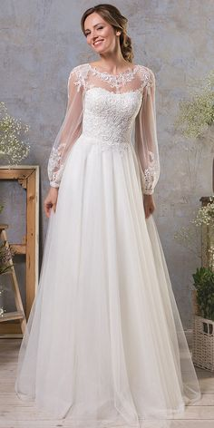 55e8dd29f9774 Charming Tulle Jewel Neckline A-line Wedding Dress With Lace Appliques    Detachable Skirt Bishop