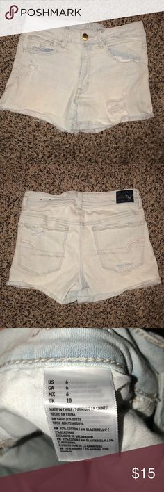 AE Hi Rise Shorties Light wash destroyed shorties! Great for spring and summer. Runs small. Typically wear a size4, these are size 6. Still in great shape, slightly worn. American Eagle Outfitters Shorts Jean Shorts