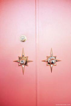 Statement gold star doorknobs on a front door