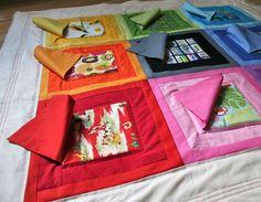 "Peek-A-Boo Play Quilt...choose fabrics w/prints that you can ""fussy"" cut around. Cute idea!"