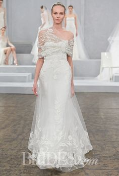 """Brides.com: . """"Hemingway"""" strapless embroidered tulle A-line wedding dress with a sweetheart neckline and matching embroidered shrug, Monique Lhuillier"""