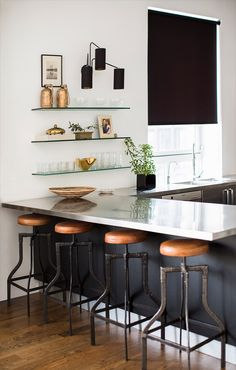 True Colors with designers Nate Berkus and Jeremiah Brent, black and white kitchen, open shelves in kitchen, vintage leather bar stools