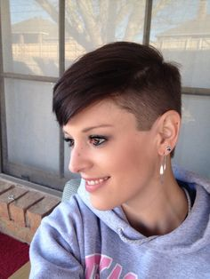 Attractive undercut style pixie. Nice!