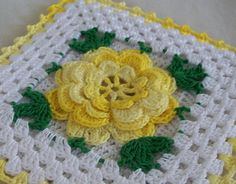 Thread crochet flower potholder, crocheted from vintage 1950's pattern. Large shaded yellow Irish crochet rose with green accents and yellow edging. Square, measures six inches across. Loop on back for hanging. Crocheted with #10 crochet cotton and steel hook.