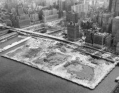 Here, a 1968 aerial view of the site where the World Trade Center was built.