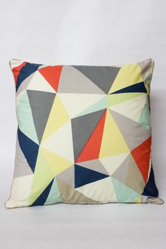 Facet Triangle Pillow. I have the bigger version of this and love it enough to get another.