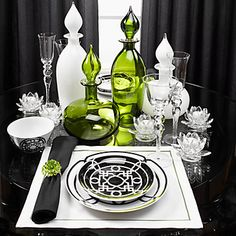 A black & white dining room, accented with a vibrant Apple Green glassware.