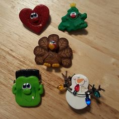 Lot of 5 Holiday Lapel Pins Made of polymer clay. Red glittery heart, Christmas tree,  Snowman with holiday lights, Thanksgiving turkey & Frankenstein.  Would be cute for a teacher or someone that works with the public. Jewelry Brooches