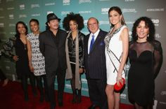 "Lucinda Martinez, Jackie Gagne, Carlos Santana, wife Cindy Blackman Santana, Clive Davis, Gabriela Isler and Shelly Brown attend the HBO Latino NYC Premiere of ""Santana: De Corazon"" (Photo by Jerritt Clark/Getty Images for HBO Latino)"