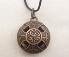 Aromatherapy locket Celtic Cross Copper color Alloy on 24 in black wax cord with 10 refill pads: Jewelry: Amazon.com