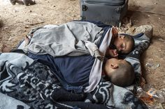 Brothers Muradeen (6) and Omar (3 and 1/2) sleep as they wait with their family in a tent, just after crossing the Syrian/Jordanian border. The family have just become refugees after fleeing #Syria.  UNHCR / S. Rich / April 2013