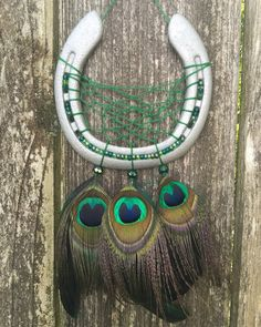 A personal favorite from my Etsy shop https://www.etsy.com/listing/464976759/peacock-horse-shoe-dream-catcher