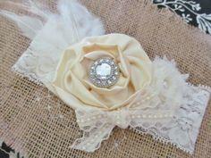 Vintage inspired Ivory satin lace headband,chiffon netting,cream feather headband-newborn, baby,girl headband-photo prop-flower girl- bridal. $14.95, via Etsy.