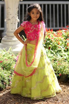 Dress up your little diva in a plush Silk .The bright Green,Pink colour of the Lehenga Choli looks charming and pretty. This Lehenga Choli will make your dear little angel look adorable for any spe. Girls Dresses Sewing, Cute Girl Dresses, Gowns For Girls, Frocks For Girls, Little Girl Dresses, Baby Dresses, Lehenga Choli Designs, Kids Lehenga Choli, Chaniya Choli For Kids