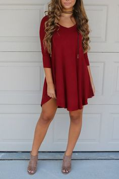 V-neck shift dress 3/4 sleeves Pretty burgundy color Rounded side dip hemline Made in the USA Model Addiis 5'6 and wearing a small Material is Rayon and Spande