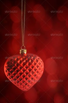 Red heart ornament hanging ...  affection, anniversary, celebration, christmas, cupid, date, dating, day, decoration, design, element, event, fabric, feeling, glass, hanging, heart, holiday, isolated, love, ornament, pendant, red, ribbon, romanticism, satin, silk, symbol, textile, texture, valentine