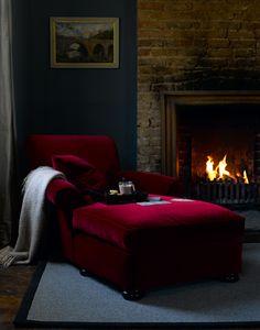 Dark blue walls, red couch.