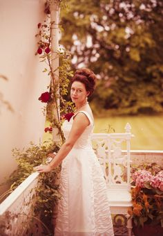Cecil Beaton - fine colour transparency - portrait of HRH The Princess Margaret wearing a white dress with red rose standing on a veranda, 25cm x 17.5cm