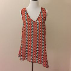 Foreign Exchange tank top Super cute orange tank top. Sheer. Slight used. Excellent condition. Perfect for summer Foreign Exchange Tops Tank Tops