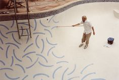 David Hockney painting his pool.