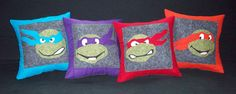 Teenage Mutant Ninja Turtle pillows!  (paper-pieced pattern designed by Schenley Pilgram from Fandom in Stitches)