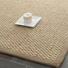 Natural-hued sisal rug.   Product: RugConstruction Material: SisalColor: Natural  Features: Made in India Note: Please be aware that actual colors may vary from those shown on your screen. Accent rugs may also not show the entire pattern that the corresponding area rugs have.Cleaning and Care: Professional cleaning recommended