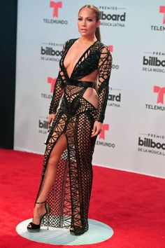 cheap for discount 57cb2 a8d0e Jennifer Lopez looks dazzling stunning in a lace dress and high heels at  the 2017 Sexy