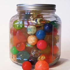 new and vintage toys displayed in simple glass jars.Croxton Design